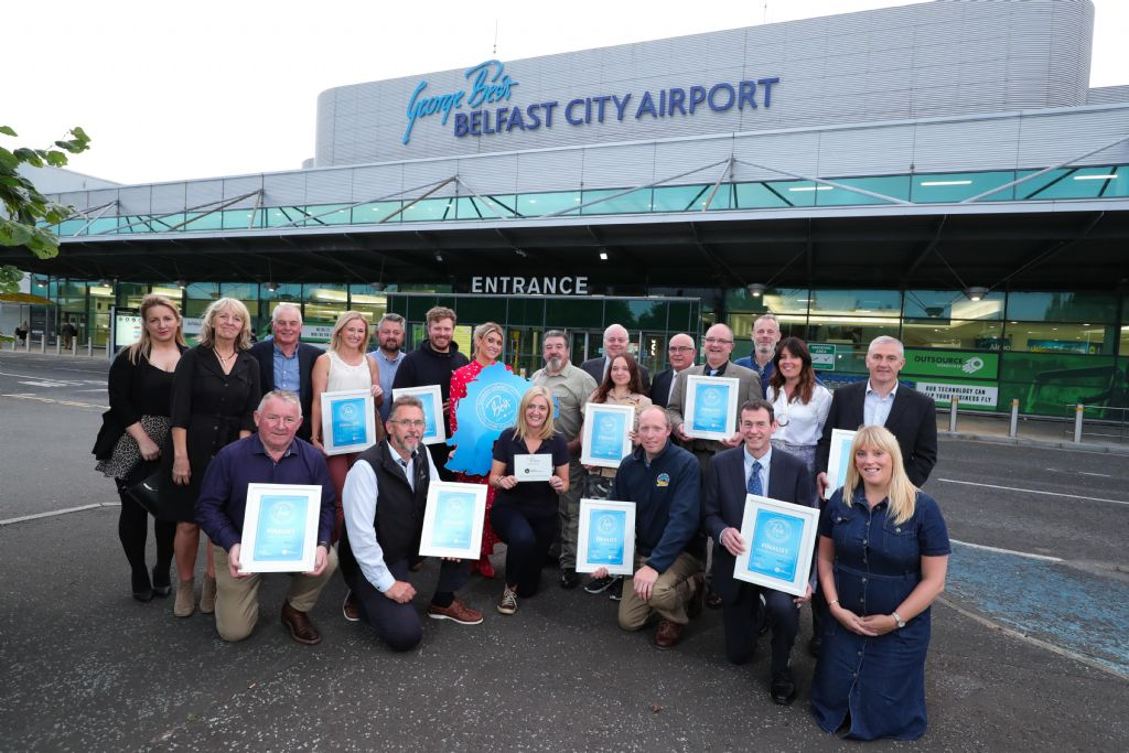 finalists pictured with juding panel at belfast city airport.JPG